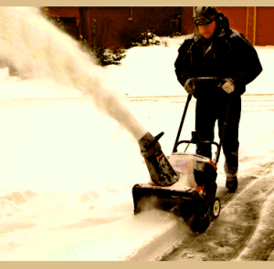 Man with snowblower